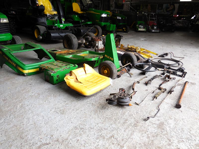 Lawnmower being repaired