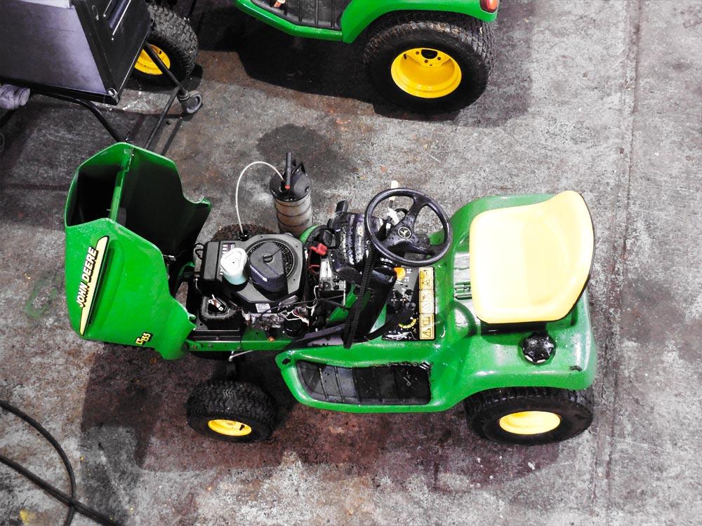 John Deere lawnmower being serviced.